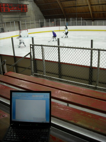 Blogging at a hockey game.