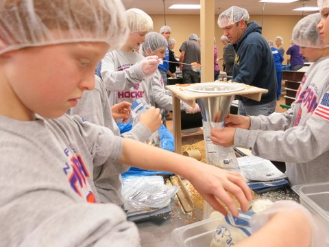 Packing meals to be sent to Haiti.