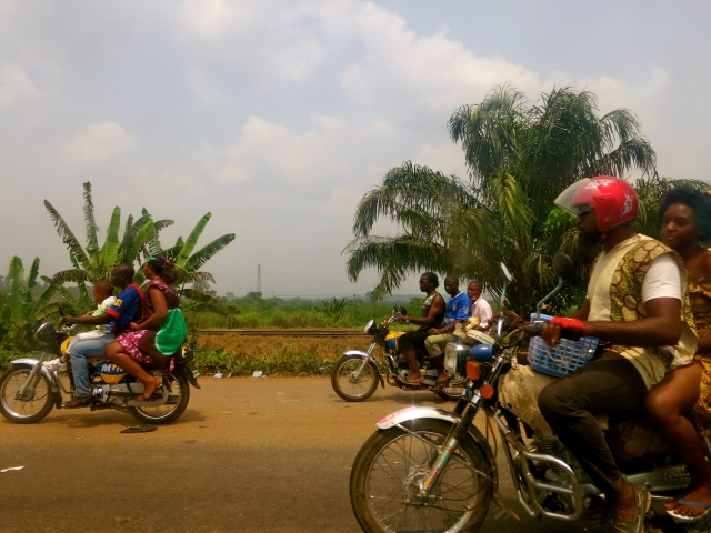 Motorcycle taxis speed toward Douala, Cameroon's major port and commercial center