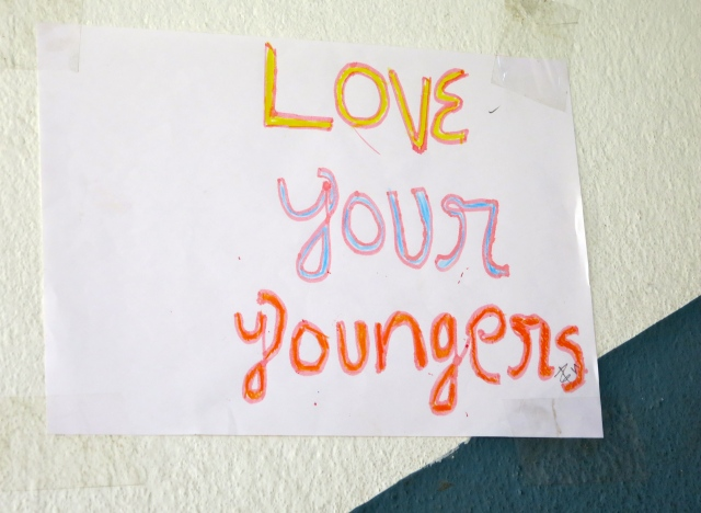 Love your youngers!  (Sign posted on the wall of a school in Nepal.)