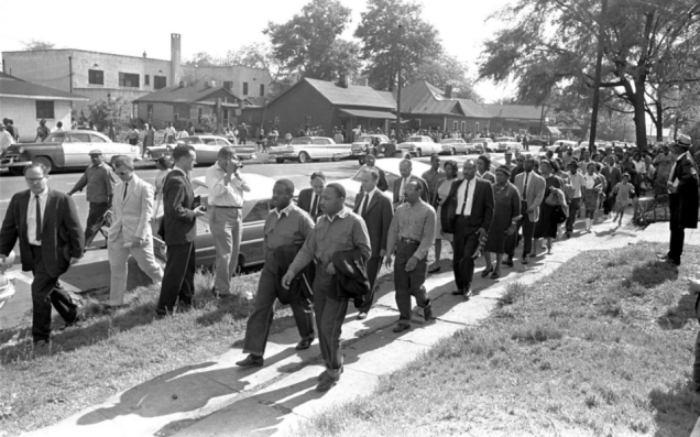 On April 12, 1963, Rev. Ralph Abernathy  and Rev. Martin Luther King Jr. lead demonstrators as they march in Birmingham. Police stopped them before they reached their goal of city hall. AP Photo/Horace Cort  Photo retrieved from Al Jazeera America.