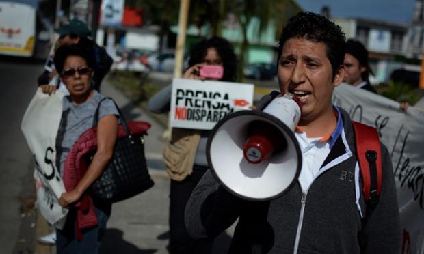 Jorge Sánchez, son of the missing journalist Moisés Sánchez Cerezo demands his father's release outside the municipal building of Medellín de Bravo, Veracruz, Mexico. Photograph: IMG Veracruz/Demotix/Corbis.  Retrieved from TheGuardian.com